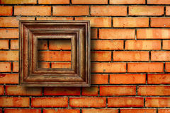 Vintage wooden frames for pictures on brick wall Royalty Free Stock Photos