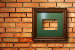 Vintage wooden frames for pictures on brick wall Stock Photo
