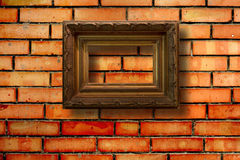 Vintage wooden frames for pictures on brick wall Royalty Free Stock Images