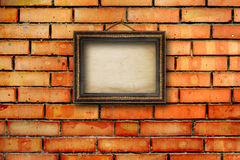 Vintage wooden frames for pictures on brick wall Stock Photography