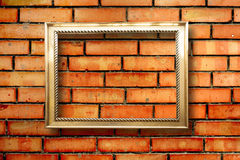 Vintage wooden frames for pictures on brick wall Stock Images