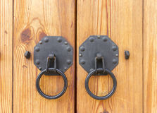 Vintage wooden gate with two door knocker closeup Royalty Free Stock Image
