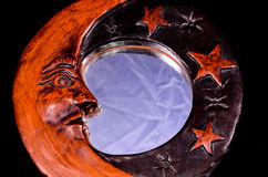 Vintage Wooden Handmade Mirror with Moon and Stars. On a Black Background Royalty Free Stock Photography