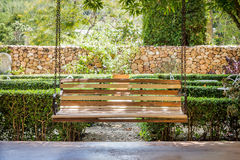 Vintage wooden hanging seat on an airy porch Stock Photography