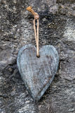 Vintage wooden heart in front of rocky background Royalty Free Stock Photos