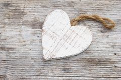 Vintage wooden heart on an old wooden beackground Stock Photos