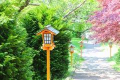 Vintage wooden lamp post. Stock Photo