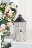 Vintage wooden lantern on classic white terrace. Stock Photos