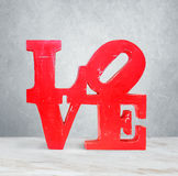 Vintage wooden letters love. Vintage red wooden letters love stock photos
