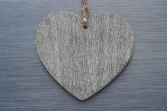 Vintage wooden love heart brushed metal background Stock Images