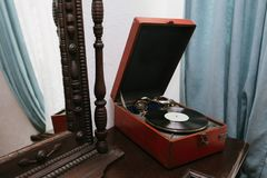 Vintage mirror and old gramophone Stock Image