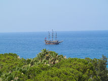 Vintage wooden old ship in blue sea Royalty Free Stock Image