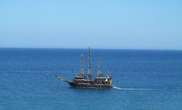 Vintage wooden old ship in blue sea Royalty Free Stock Photos