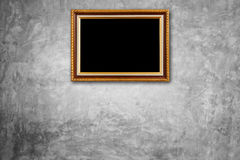 Vintage wooden photo frame hang on natural stone wall. Interior Royalty Free Stock Photo
