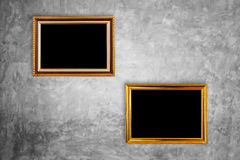 Vintage wooden photo frame hang on natural stone wall. Interior Royalty Free Stock Image