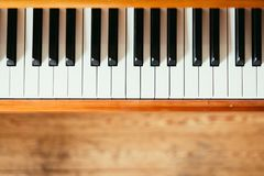Vintage wooden piano keys, wooden blurry floor. Vintage wooden piano. Keys in the foreground, wooden floor in the blurry background instrument rustic jazz stock images
