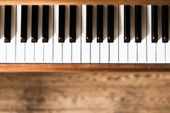 Vintage wooden piano keys, wooden blurry floor. Vintage wooden piano. Keys in the foreground, wooden floor in the blurry background instrument rustic jazz royalty free stock photos