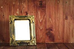 Vintage wooden picture frame on the desk. Stock Photos