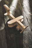Vintage wooden plane on wooden board Stock Photos