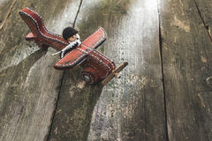 Vintage wooden plane on wooden board Stock Images