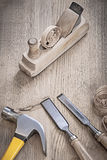 Vintage wooden planer and chissels.  Stock Photo
