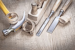 Vintage wooden planer and chissels with shavings.  Stock Photos