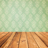 Vintage wooden planks over bokeh green background stock image