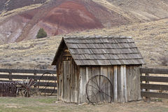 Vintage Wooden Pump House With Wagon Wheel stock photo