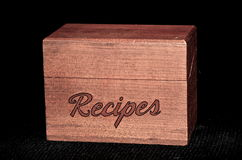 Vintage wooden recipe box. My grandmothers wooden recipe box, set in front of a black background Stock Photos