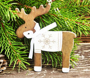 Vintage Wooden Reindeer Christmas Decoration and Fir Tree Branch Stock Photos
