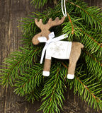 Vintage Wooden Reindeer Christmas Decoration and Fir Tree Branch Stock Image