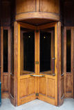 Vintage wooden revolving door. Old fashioned wooden revolving door Royalty Free Stock Photo