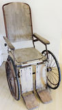 A Vintage Wooden Rolling Chair, or Wheelchair Stock Photos