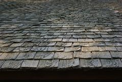Weathered dark texture of wooden tile roof stock image
