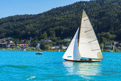 Vintage wooden sailboat on lake, sailing on Worthersee, Carinthi Royalty Free Stock Photos