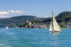 Vintage wooden sailboat on lake Worthersee at Maria Worth Royalty Free Stock Images