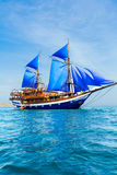 Vintage Wooden Ship with Blue Sails Royalty Free Stock Photography