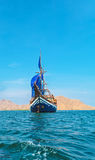 Vintage Wooden Ship with Blue Sails Royalty Free Stock Image