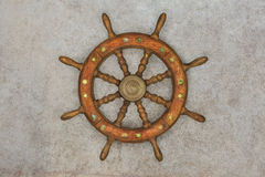 Vintage wooden ship steering wheel on a retro background Royalty Free Stock Images