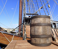 Vintage wooden shipping barrel. With a boat in the background Stock Images