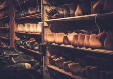 Vintage wooden shoe lasts in a row on the old shelves. Royalty Free Stock Photo