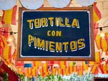 Free Vintage Wooden Signboard At A Fair Announcing Spanish Omelette With Peppers. Royalty Free Stock Images - 117315809
