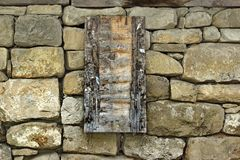 Vintage Wooden Signboard on Old Stone Wall Royalty Free Stock Photography