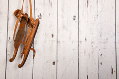 Vintage wooden skates. Hanging on wooden wall Royalty Free Stock Images