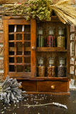 Vintage Wooden Spice Rack or Storage Cabinet and six glass bottl Stock Images