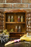 Vintage Wooden Spice Rack or Storage Cabinet and six glass bottl Stock Photography