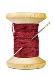 Vintage wooden spool of thread and needle on white background Stock Photos