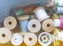 Vintage wooden spools of thread in a box Stock Images