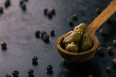 Vintage wooden spoon with capers Royalty Free Stock Photography
