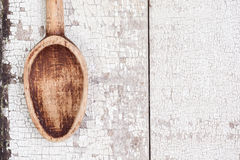 Vintage wooden spoon on rustic table Stock Images